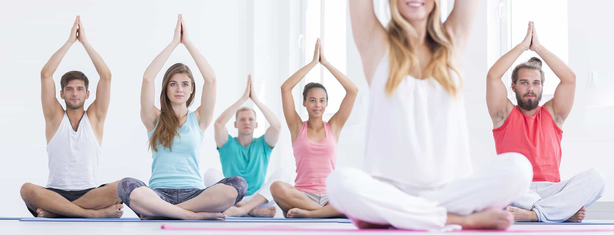 Focused people during yoga class looking at their instructor